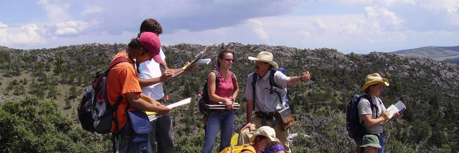 professor talking to students on a trail