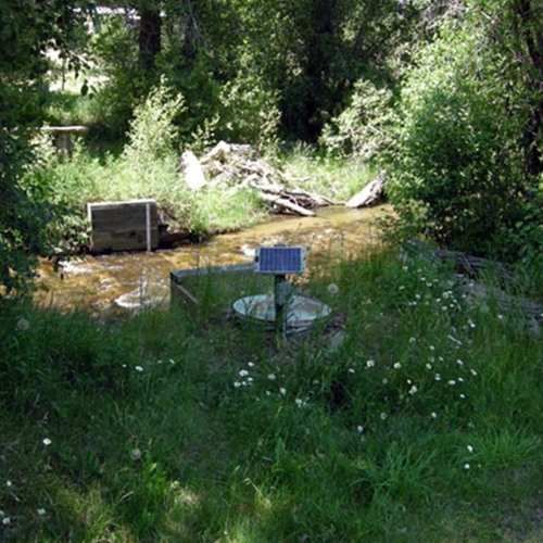 watershed instrumentation next to flowing stream