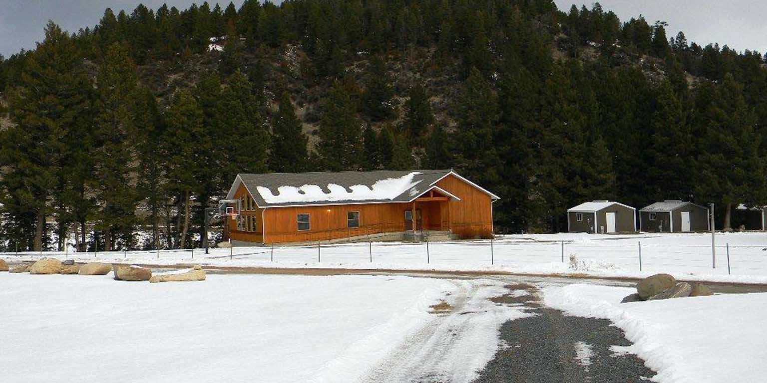 Field station main building with snow and mountain behind
